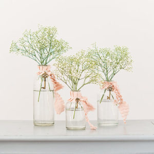 Simple wedding centerpiece glass bottle